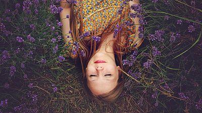 Women lying in flowers