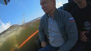 Putin explores sunk Soviet submarine in Bond-style dive