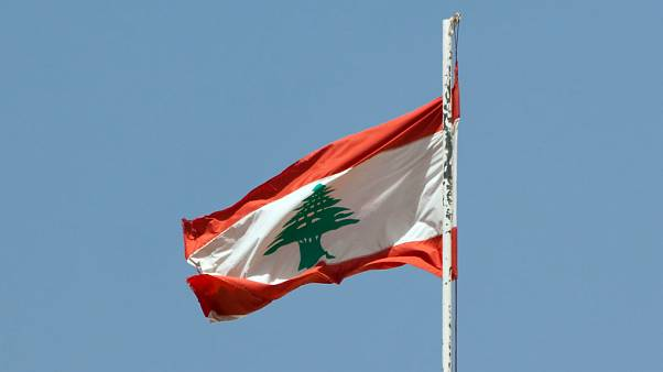 The lebanese flag floating over the palace of Beiteddine.