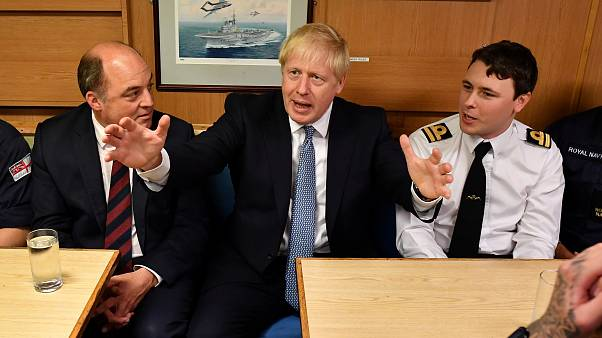 Boris Johnson and Defence Secretary Ben Wallace meet crew members in the mess hall as they visit HMS Victorious at HM Naval Base Clyde in  Scotland, Britain July 29, 2019