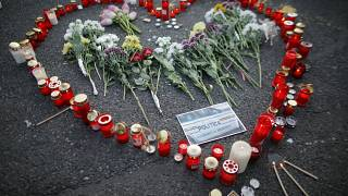Flowers and candles are left by people during an anti-government demonstration in Bucharest, Romania, July 27, 2019.