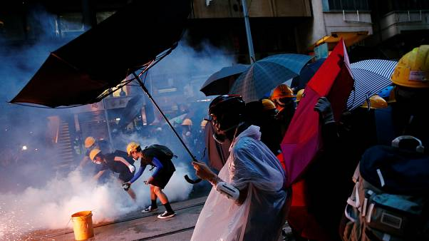 Hong Kong police charge 44 protesters with rioting offence