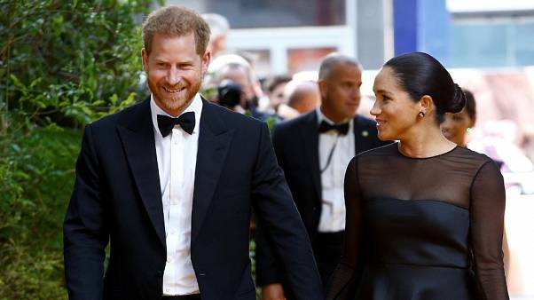 "Britain's Prince Harry and Meghan, Duchess of Sussex attend the European premiere of ""The Lion King"" in London"