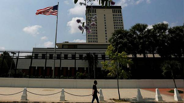 A man walks in front of the U.S. Embassy in Phnom Penh, Cambodia, April 14, 2018. REUTERS/Samrang Pring