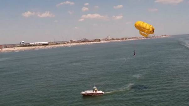 Watch: Basketball star Julian McClurkin scores trick shot while parasailing