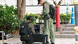 Police Explosive Ordnance Disposal (EOD) officers work following a small explosion at a site in Bangkok, Thailand, August 2, 2019.