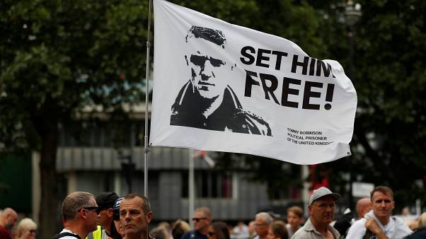 Supporters of far-right activist Tommy Robinson protest outside the Houses of Parliament in London, July 11, 2019.