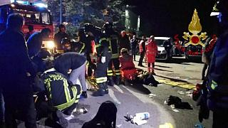 Emergency personnel attend to victims of a stampede at a nightclub in Corinaldo, near Ancona, Italy,  in this handout picture obtained by Reuters December 8, 2018.