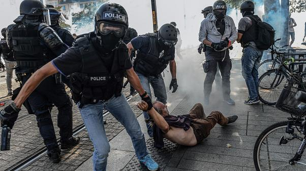 Anti-criminality brigade (BAC) police officers arrest a man during a gathering in Nantes