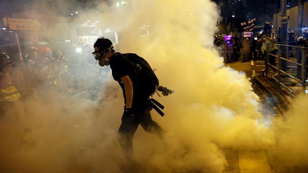 Riot police clash again with protesters in Hong Kong