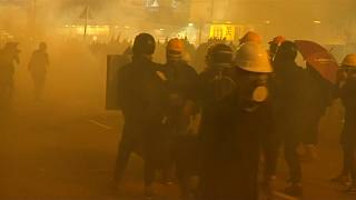 Police fire tear gas during anti-government protests in Hong Kong