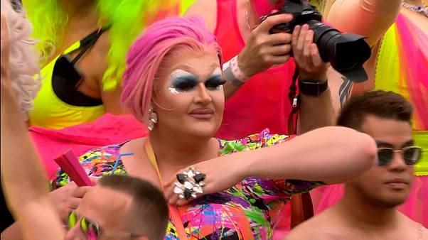 Tens of thousands line Amsterdam canal for gay pride boat parade