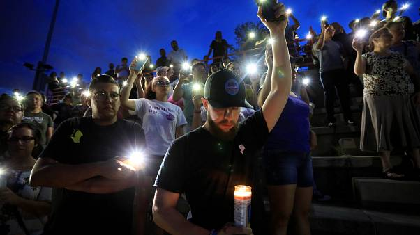 Mourners take part in a vigil at El Paso High School after a mass shooting at a Walmart store in El Paso. August 3, 2019.