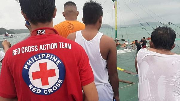 Philippine Red Cross personnel oversee a rescue operation on one of the capsized ferries in the central Philippines, August 3, 2019.