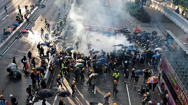 Demonstrators disperse after a tear gas is fired by Hong Kong police in Hardcourt Road, Admiralty, in Hong Kong, China, August 5, 2019.