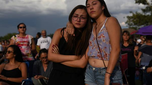 Amber Ruiz and Jazmyn Blake embrace during a vigil a day after a mass shooting at a Walmart store in El Paso, Texas, U.S. August 4, 2019.