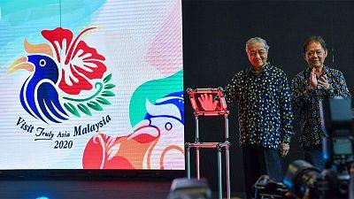 Left: Tun Dr. Mahathir Mohamad, Prime Minister of Malaysia; Right: YB Datuk Mohamaddin bin Ketapi, Minister of Tourism, Arts and Culture Malaysia