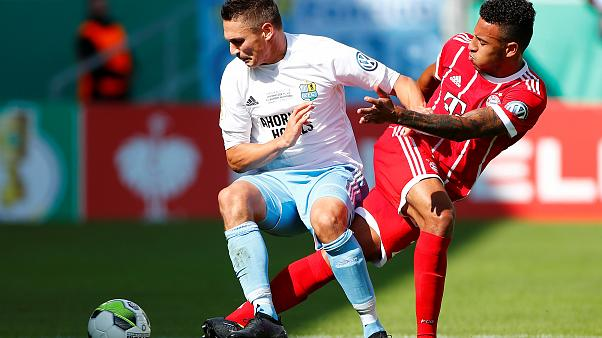 Bayern Munich's Corentin Tolisso in action with Chemnitzer's Daniel Frahn (left)