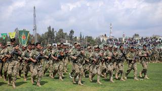 FILE PHOTO: Kurdish fighters from the People's Protection Units (YPG) take part in a military parade, in Qamishli, Syria, March 28, 2019.
