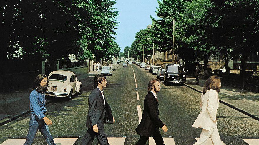 Members of the Beatles, George Harrison, Paul McCartney, Ringo Starr, John Lennon, cross Abbey Road in London, Britain, August 8, 1969