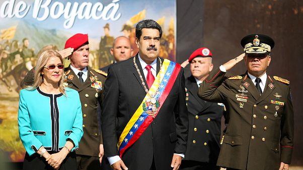 El presidente de Venezuela, Nicolas Maduro, junto a su esposa y el ministro de Defensa Vladimir Padrino