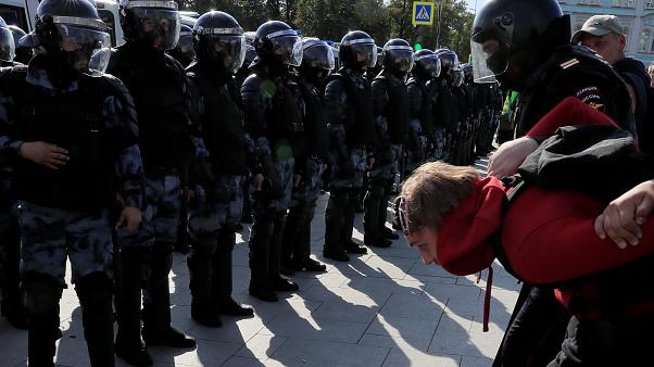Law enforcement officers detain a participant in a rally calling for opposition candidates to be registered for elections to Moscow City Duma on August 3