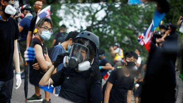 Police fire tear gas at anti-government protesters in Hong Kong