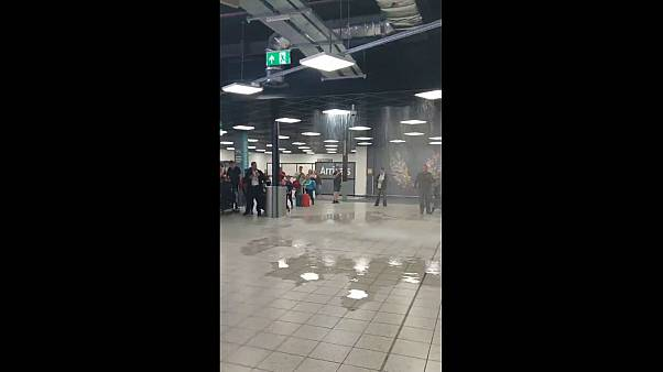 Watch: Water pours through ceiling into Luton Airport