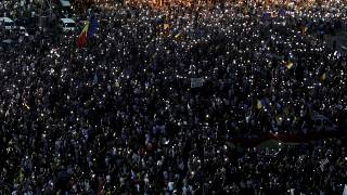 Thousands rally in Bucharest on anniversary of violent protest