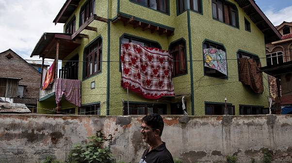 Some signs of normality return to Kashmir, but India's clampdown still strict