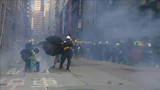 Police in Hong Kong fire tear gas as street protests continue