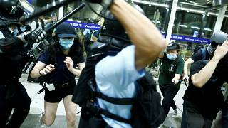 Police clash with protesters at Hong Kong International Airport