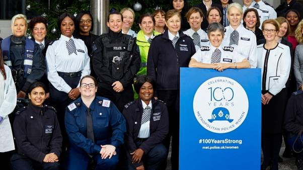 Khafi (back row, third from left) was part of the campaign to celebrate 100 years of women in the Met Police