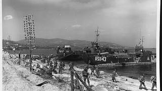 "USS LCI-513 and LCT-1143 unloading on a Southern France beach, on ""D-Day"", 15 August 1944."