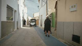 Elderly woman walks along a purpose-built non-slip path