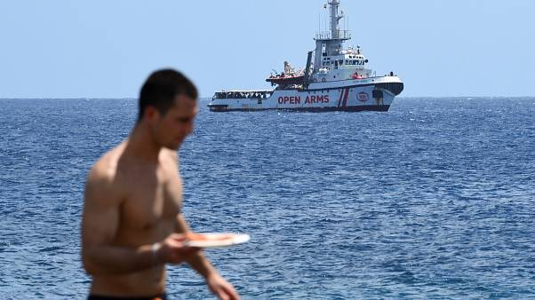 Italian PM says six EU countries have offered to take the stranded Open Arms migrants