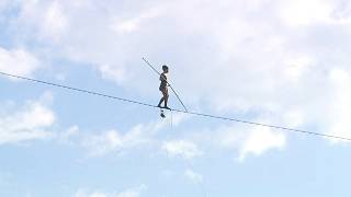 French tightrope walker wows Czech crowd with Vltava River crossing