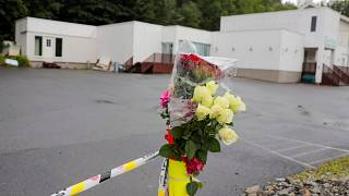 Flowers and a police tape are seem outside Al-Noor Islamic Centre Mosque, a day after a gunman's attack, in Baerum outside Oslo, Norway, 12 August, 2019.