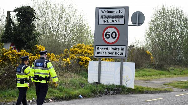 Irish police officers patrol along the border between Ireland and Northern Ireland