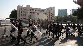 Turkish police walk in front of the Metropolitan Municipality headquarters in Diyarbakir, Turkey, August 19, 2019.