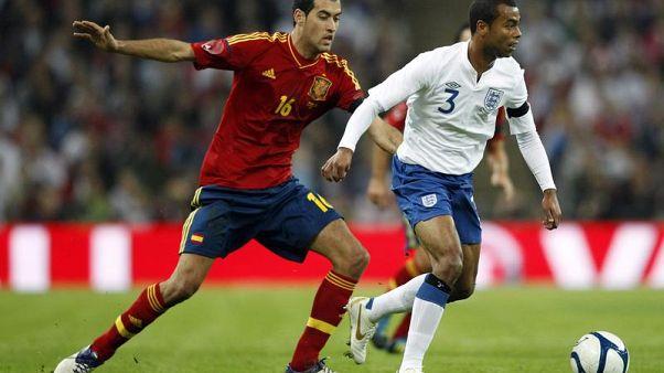 Amichevole Inghilterra-Spagna: Ashley Cole e Sergio Busquets. (Wembley, 12.11.2011).