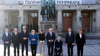 German Chancellor Angela Merkel and President Frank-Walker Steinmeier pose with other dignitaries at an event to mark 100 years since the Weimar constitution was signed in 191