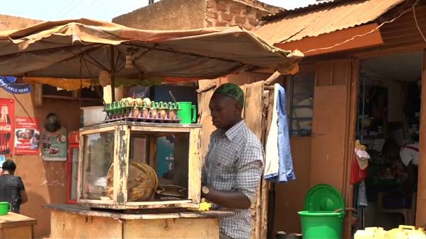 Street traders in Kampala work in shifts throughout the day and night