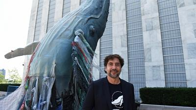 Javier Bardem posed next to the a 19ft tall sculpture representing threats to marine life