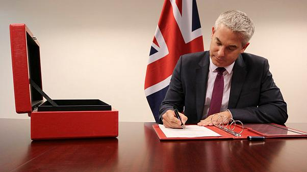 Brexit Secretary Stephen Barclay signs the commencement agreement to leave the EU
