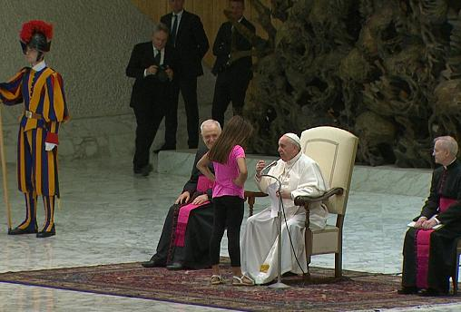 'Don't worry, let her be!' Young girl wanders on stage during pope's audience