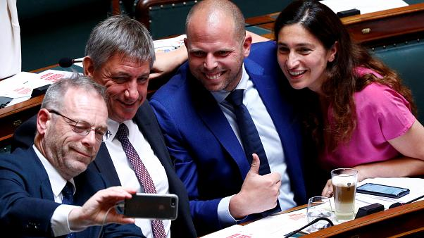 N-VA party members De Roover, Jambon, Francken and Demir pose for a selfie during a plenary session of the Belgian Parliament in Brussels