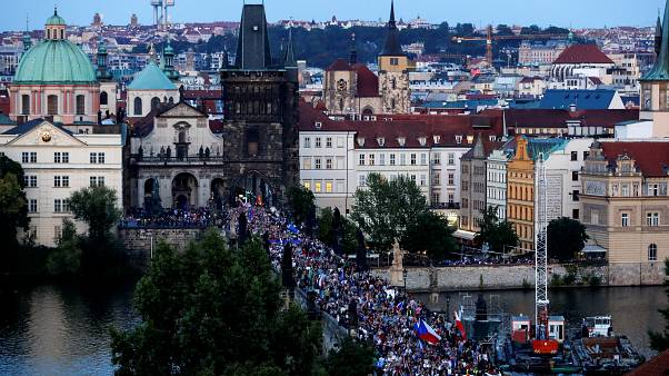 Demonstrators march during a protest rally demanding resignation of Czech Prime Minister Andrej Babis and President Milos Zeman.