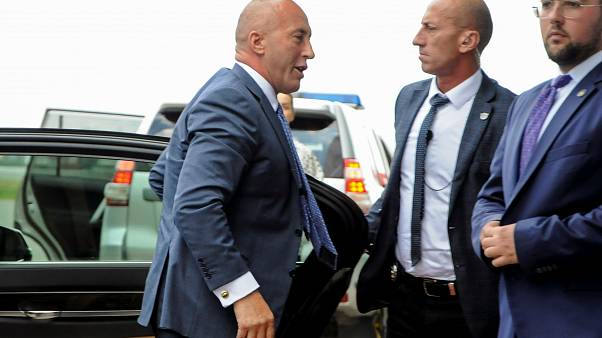 Kosovo's former Prime Minister Ramush Haradinaj arrives at Pristina Airport after being called to The Hague war crimes court regarding Kosovo's violent independence struggle