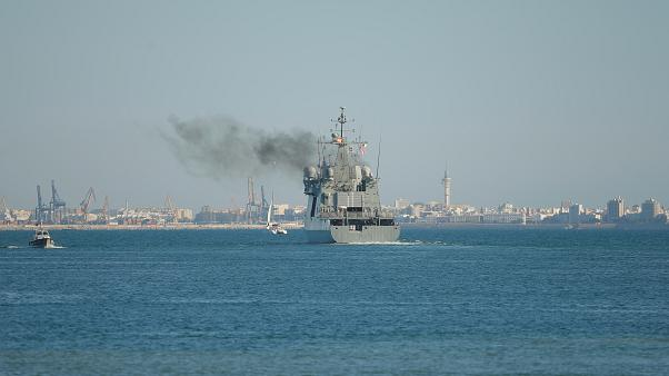 Watch again: Spanish warship Audaz arrives off Lampedusa coast to collect 15 migrants